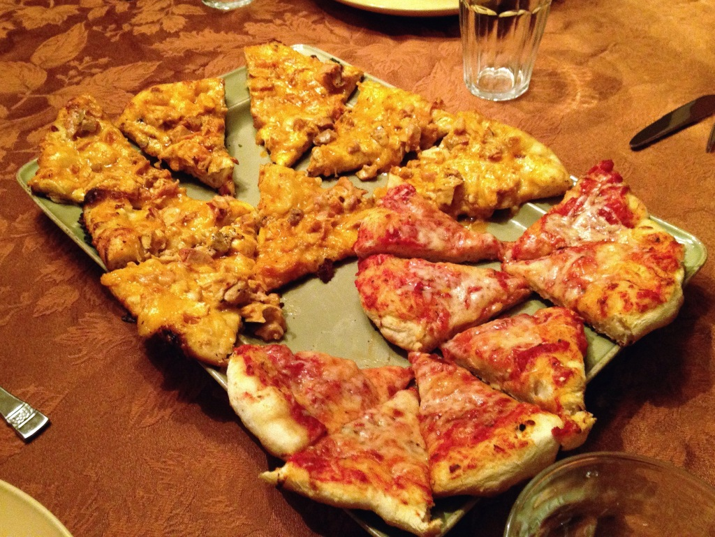 Cheese pizza and buffalo chicken pizza