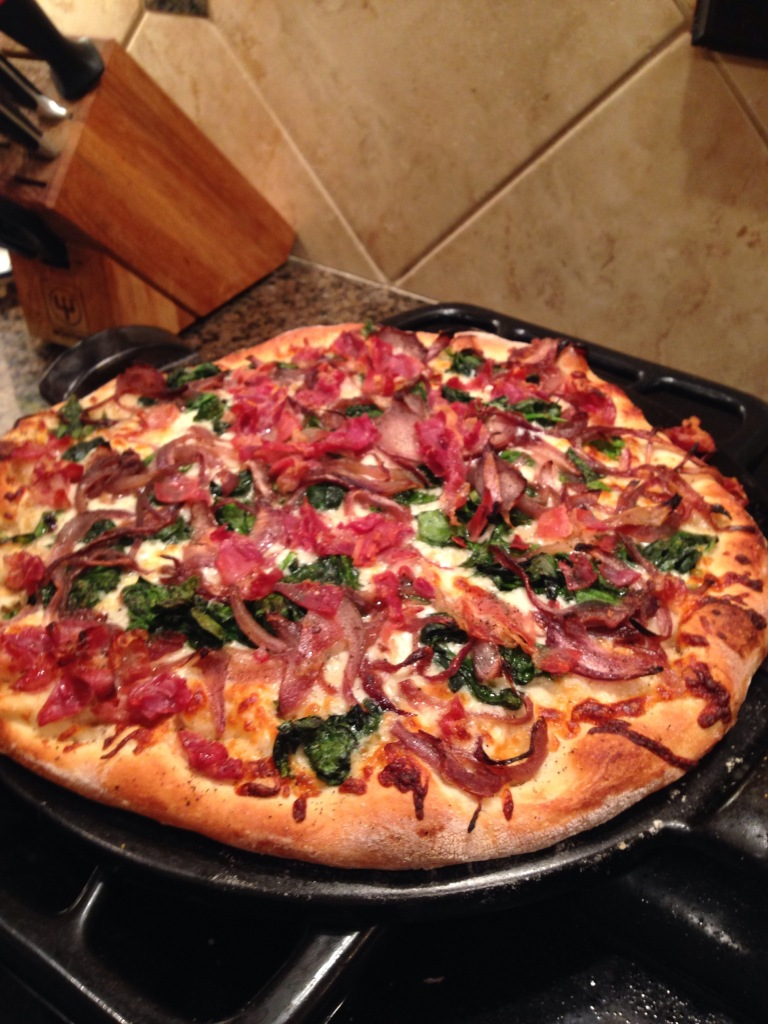 Spinach, carmelized onion and bacon pizza