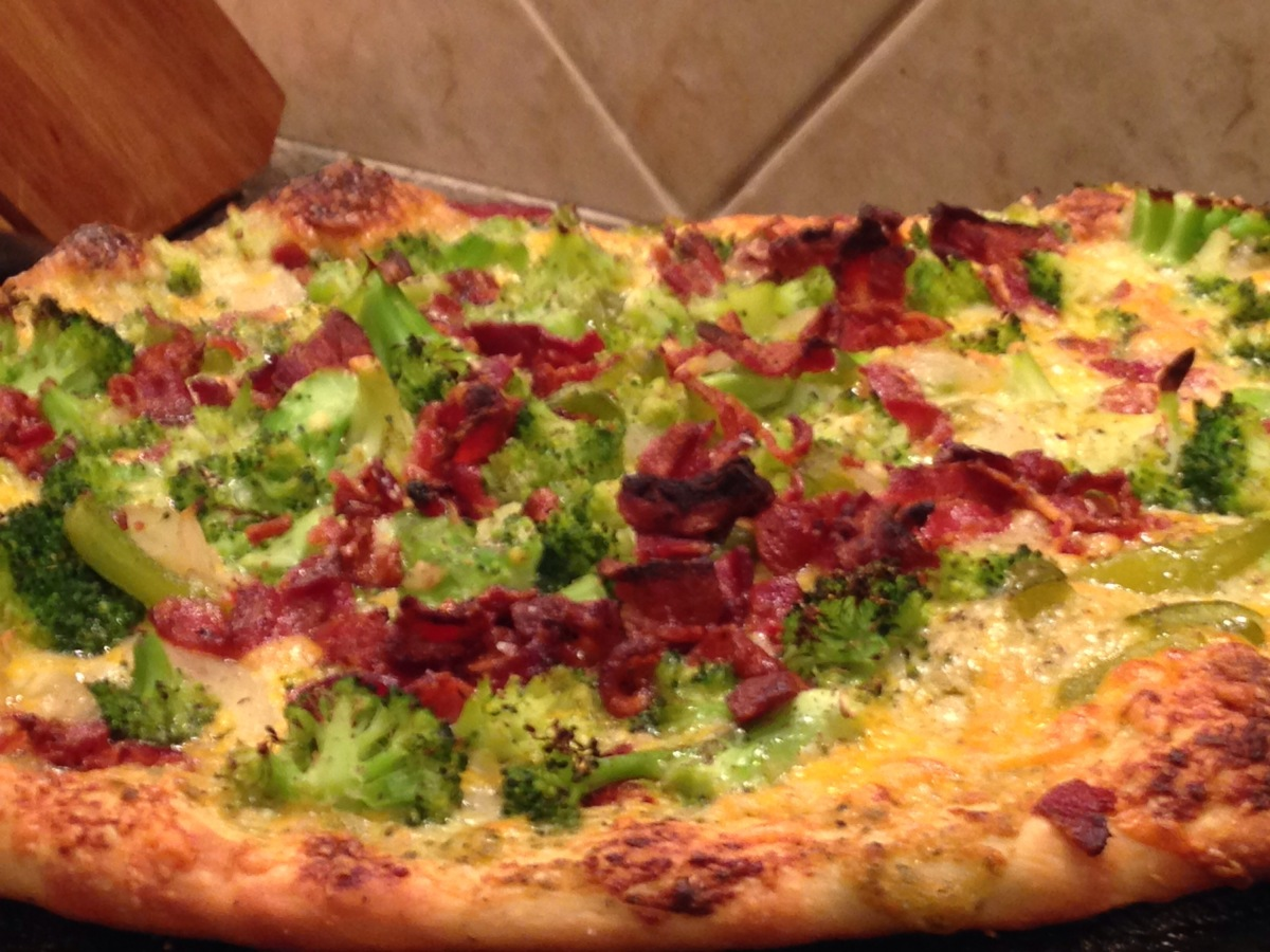 Broccoli, bacon and tomato pizza with cheddar cheese